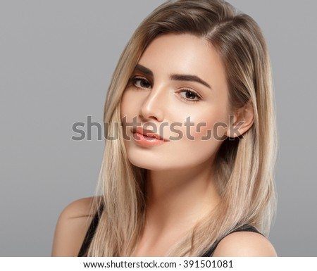sensual fashion closeup portrait of young pretty woman blond on gray background  - stock photo