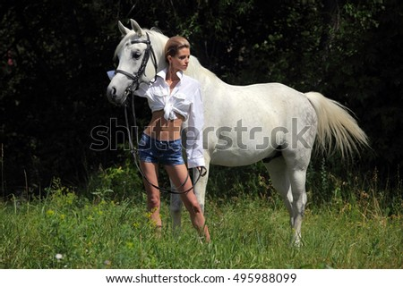 Sensual fashion model with a horse