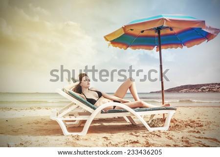 Sensual girl at the beach  - stock photo