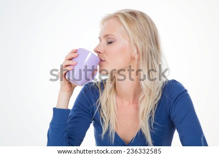 sensual girl drinks delicious infusion - profile of woman with long and blond hair