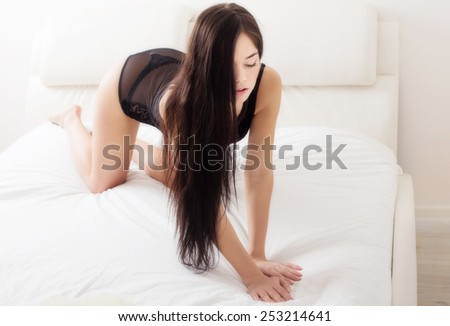sensual girl in white bed - stock photo
