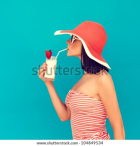 sensual girl with a summer cocktail
