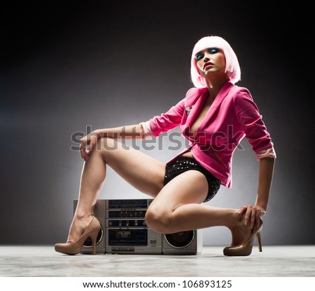 Sensual girl with a tape recorder - stock photo