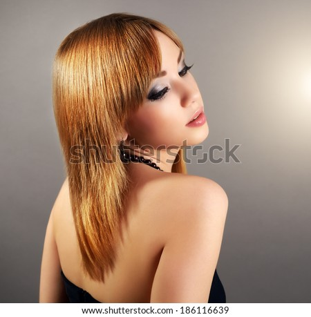 Sensual girl with straight hair and beautiful makeup on black background
