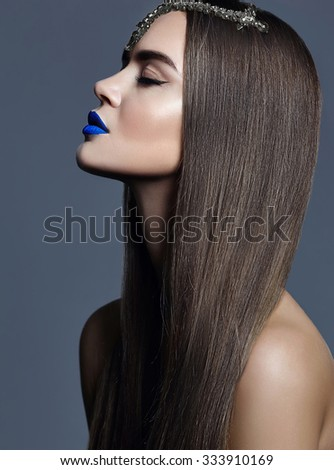 sensual glamour portrait of beautiful  woman model lady with colorful makeup with blue lips  and jewelry