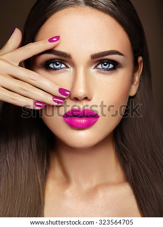 sensual glamour portrait of beautiful  woman model lady with fresh daily makeup with purple lips color and clean healthy skin face  - stock photo