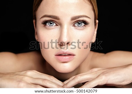 sensual glamour portrait of beautiful woman model lady with no makeup and clean healthy skin  on black background