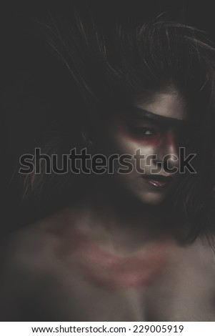 sensual latin woman, red make up in her eyes - stock photo