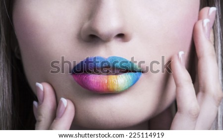 Sensual lips rainbow makeup. Beautiful bright make-up and vivid colors. Close up photography of sexy female mouth with funny summer visage - stock photo