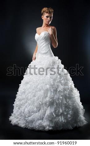 Sensual lovely bride shows white wedding dress. Series of photos - stock photo