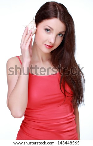 Sensual lovely girl listen natural sea sounds on white background