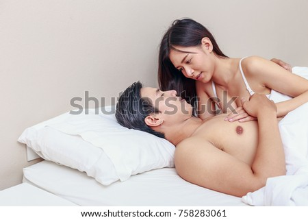 image Asian couple in bedroom