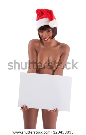 Sensual naked black ethnic African-American woman stripper in Mrs Santa Claus costume and Santa hat with branches of decorated Christmas tree - stock photo