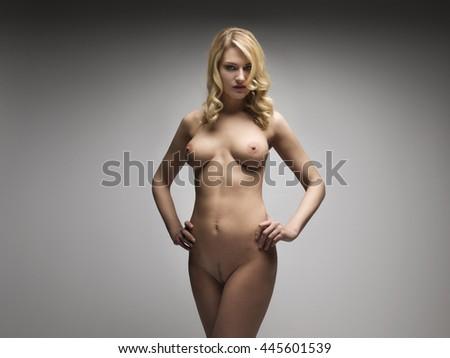 Sensual naked woman posing in studo - stock photo