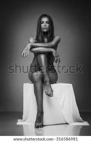 Sensual naked woman sitting, erotic pose, chairman beauty of attractive caucasian woman. - stock photo