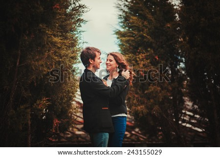 Sensual outdoor portrait of young fashion couple posing - stock photo