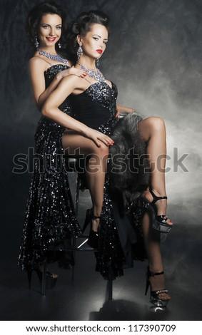 Sensual pair of provocative women girlfriends hugging. Desire. Passion - stock photo