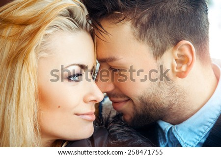 Sensual photo of young couple in love. Horizontal color image - stock photo