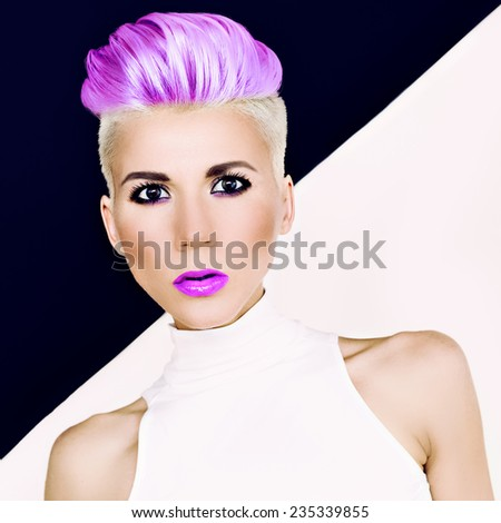 Sensual portrait Blonde girl with fashionable hairstyle and makeup. Colored Hair trend - stock photo