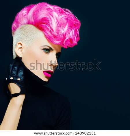 Sensual portrait Lady with fashionable haircut colored hair on  black background - stock photo