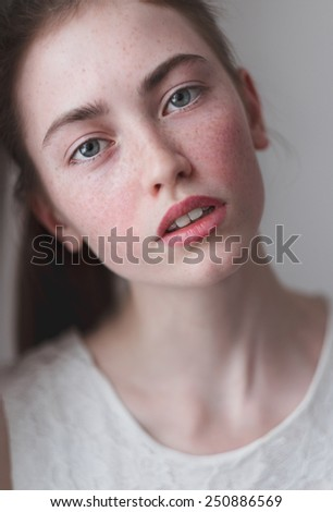 sensual portrait of beautiful girl with freckles - stock photo