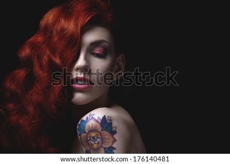 Sensual portrait of beautiful girl with tattoo - stock photo