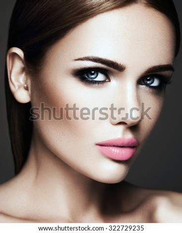 sensual portrait of beautiful  woman model lady with fresh daily makeup with nude lips color and clean healthy skin face  - stock photo