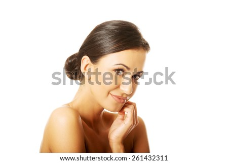 Sensual portrait of nude woman looking at the camera. - stock photo
