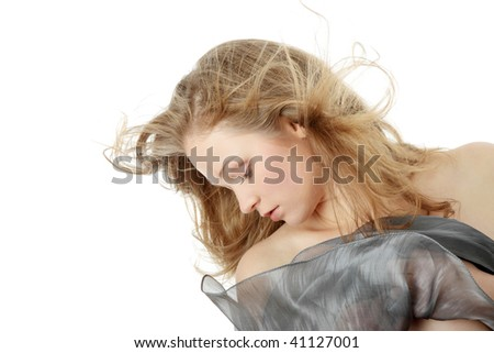 Sensual portrait of young beautiful caucasian woman dancing with wind. Isolated on white