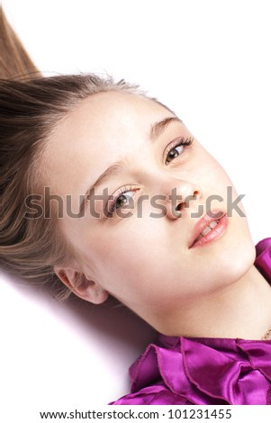 Sensual pretty woman lying on the floor, close up, looking up, in pink dress - stock photo