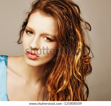 Sensual pretty woman with beautiful long blond curly  hairs - stock photo