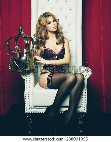 sensual princess woman in black lingerie sitting on throne - stock photo