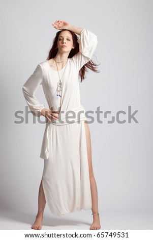 sensual red hair  woman in elegant fine white dress, studio shot
