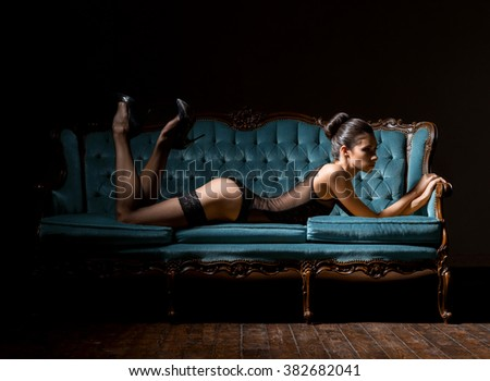 Sensual seductive young woman with sexy legs in hosiery posing in vintage interior.  - stock photo