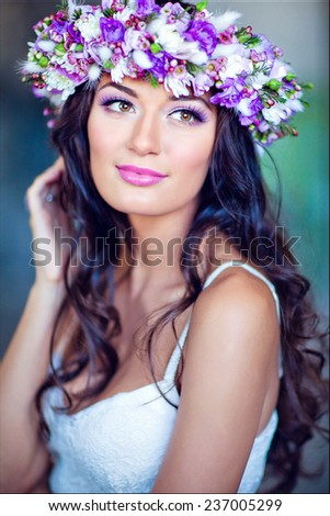 Sensual sexy beautiful curly girl in a white dress with a floral wreath on her head , close up - stock photo