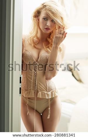 Sensual sexy blond woman posing - stock photo