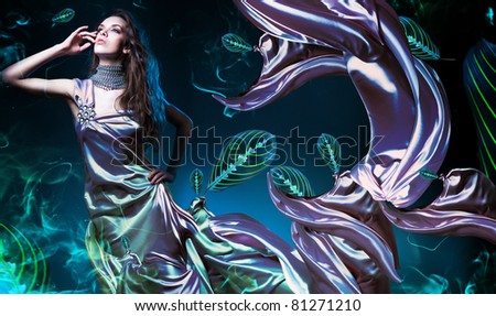 sensual sexy woman in fabric with leaves - stock photo