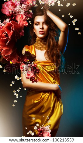 sensual sexy woman in green dress with flowers and blue light - stock photo