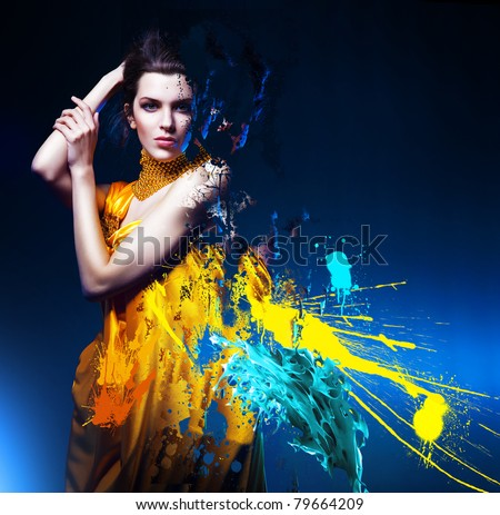 sensual sexy woman in long yellow dress and splatter - stock photo