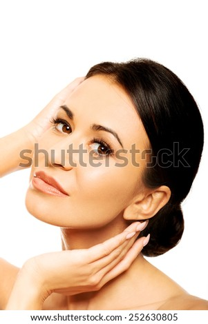 Sensual spa woman holding hands on chin. - stock photo