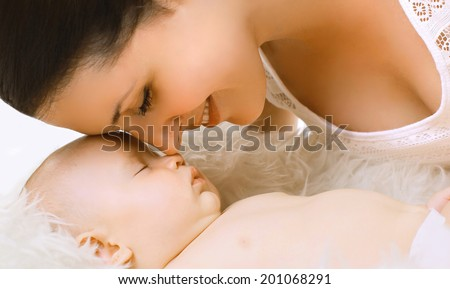 Sensual tender mom and sleep baby - stock photo