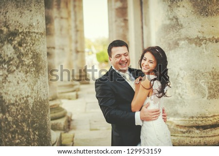 Sensual wedding Couple, groom and bride laughing - stock photo