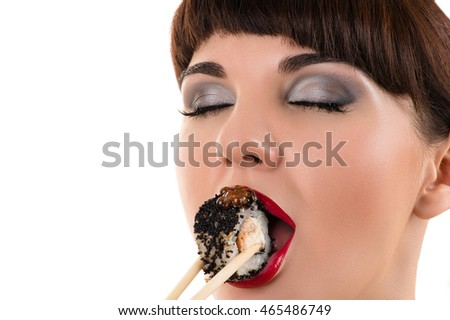 sensual woman eating roll with black caviar
