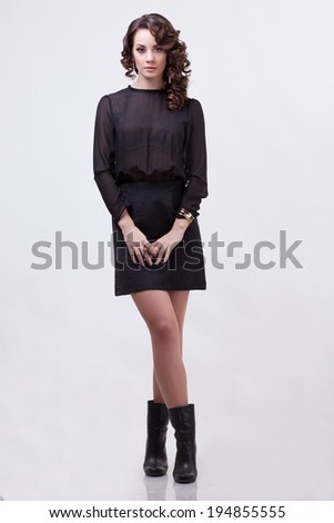 Sensual woman full body on grey background. Professional make up and hairstyle. Studio lighting - stock photo