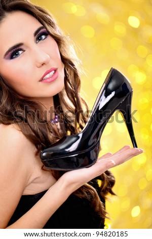 sensual woman holding high heels, concept - my dream high heels - stock photo