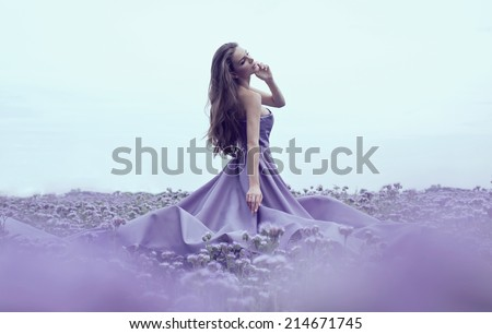 Sensual woman in blue dress  - stock photo