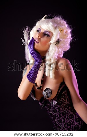 Sensual woman in fashionable corset and white Victorian wig, studio shot