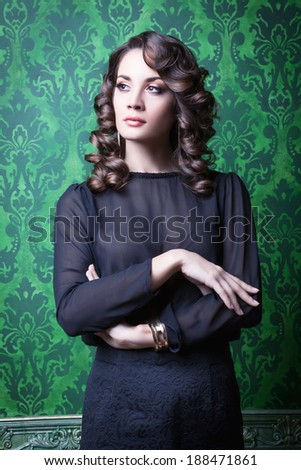 Sensual woman in green vintage interior. Professional make up and hairstyle. Studio lighting - stock photo