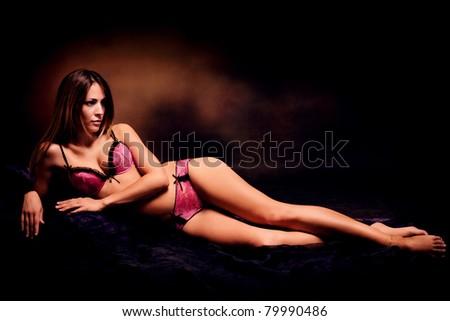 sensual woman in lingerie, studio dark background - stock photo