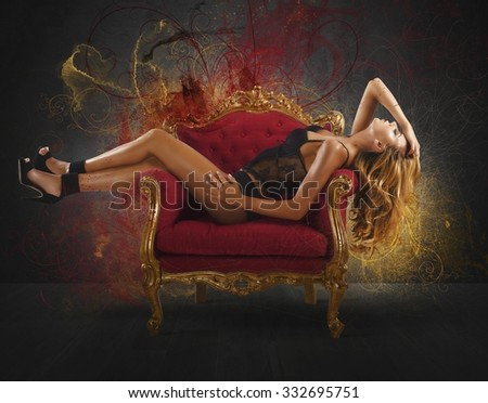 Sensual woman lying on an armchair baroque - stock photo